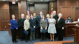 Shown from left to right are CASA Program Manager Jen Fuss; Judge Edward Dwyer Jr.; Beth Murphy; Heather Hill; Erik Pimentel: john Shatto; Ashley Rose Bennett; Sylvia Jacobs; Master Julia Minner; Judge William Nicklas, Jr.; Clerk of the Circuit Court Sandra Dalton