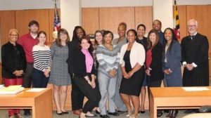 Left to right: Robin Parker-Jones, Joshua Sullivan, Molly Coplan, Emily C. Smith, Tonja Brown-Hurst, Amanda Menke, Audrey Sellers, Stacey Crest, Julie Durr, Morine Lewis, Carolyn Lynch, Anna Fernando, Derrell Frazier, Nancy Blackwell and Judge Kershaw.